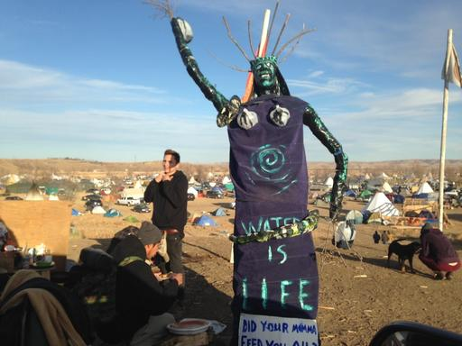 A sculpture stands at an encampment where protesters of the Dakota Access oil pipeline have been gathered for months, Saturday, Nov. 26, 2016, near Cannon Ball, N.D. Protest organizers said that they have a right to stay on the land. Their statement comes a day after the U.S. Army Corps of Engineers told they would have to leave by Dec. 5. (AP Photos/James MacPherson)