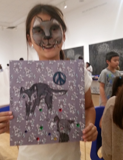 Proud young artist and her beautifully drawn Peace Flag at LAM