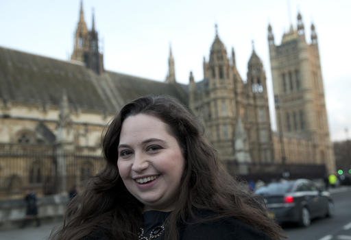 In this Tuesday, Feb. 3, 2015 file photo, Rachel Kean activist and campaigner poses for the Associated Press outside the Palace of Westminster, after she witnessed the vote on 3 parent babies in the House of Commons, in London. Britain's fertility regulator has approved controversial techniques allowing doctors to create babies using the DNA from three people — what it called a