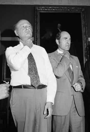 In this Aug. 7, 1981, file photo, Dr. Henry Heimlich, right, and Mayor Edward Koch demonstrate how a chocking victim should signal for help at New York's City Hall during Heimlich's discussion of his Heimlich Maneuver. Heimlich, the surgeon who created the life-saving Heimlich maneuver for choking victims has died Saturday, Dec. 17, 2016, at Christ Hospital in Cincinnati. He was 96. (AP Photo/Suzanne Vlamis, File)