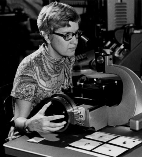 In this image taken in the 1970s and provided by the Carnegie Institution of Washington, Vera Rubin uses a measuring engine. Rubin, a pioneering astronomer who helped find powerful evidence of dark matter died Sunday, Dec. 25, 2016. She was 88. (Carnegie Institution of Washington via AP)