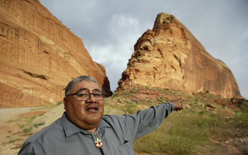 This June 21, 2016, file photo, Malcolm Lehi, a Ute Mountain Tribal Commissioner points to a rock formation near Blanding, Utah.