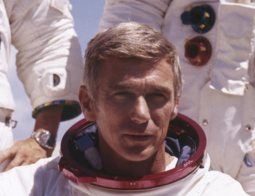 In an undated file photo provided by NASA, US Navy Commander and Astronaut for the upcoming Apollo 17, Eugene Cernan, is pictured in his space suit. NASA announced that former astronaut Cernan, the last man to walk on the moon, died Monday, Jan. 16, 2017, surrounded by his family. He was 82. (NASA via AP)