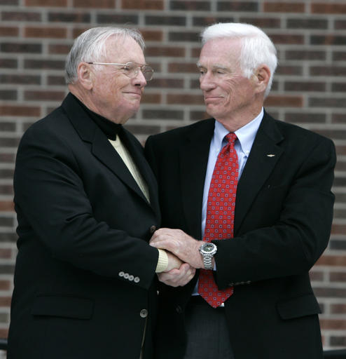 In a Oct. 27, 2007 file photo, former astronaut Neil Armstrong, left, is congratulated by fellow ex-astronaut Gene Cernan following the dedication ceremony of the Neil Armstrong Hall of Engineering at Purdue University in West Lafayette, Ind. NASA announced that former astronaut Gene Cernan, the last man to walk on the moon, died Monday, Jan. 16, 2017, surrounded by his family. He was 82. (AP Photo/Michael Conroy, File)