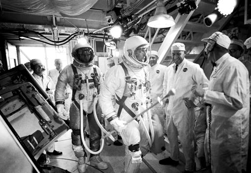 In this June 3, 1966, photo provided by NASA, Gemini IXA astronauts Eugene Cernan, left, and Tom Stafford, center, arrive in the white room atop Launch Pad 19 at Cape Kennedy Air Force Station in Cape Canaveral, Fla. NASA announced that former astronaut Cernan, the last man to walk on the moon, died Monday, Jan. 16, 2017, surrounded by his family. He was 82. (NASA via AP)