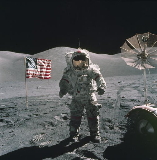 In this Dec. 12, 1972, photo provided by NASA, Apollo 17 commander Eugene Cernan stands on the moon. NASA announced that former astronaut Cernan, the last man to walk on the moon, died Monday, Jan. 16, 2017, surrounded by his family. He was 82. (NASA via AP)