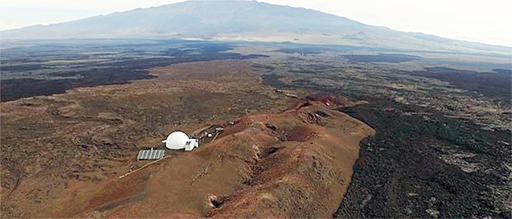 This June, 2015 photo provided by the University of Hawaii shows the domed structure that will house six researchers for eight months in an environment meant to simulate an expedition to Mars, on Mauna Loa on the Big Island of Hawaii. The group will enter the geodesic dome Thursday, Jan. 19, 2017, and spend eight months together in the 1,200 square foot research facility in a study called Hawaii Space Exploration Analog and Simulation (HI-SEAS). They will have no physical contact with any humans outside their group, experience a 20-minute delay in communications and are required to wear space suits whenever they leave the compound. (Sian Proctor/University of Hawaii via AP)