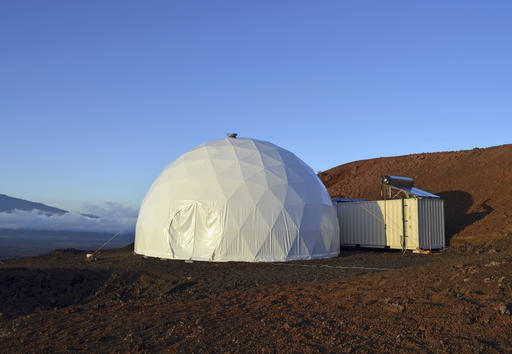 This April 25, 2013 photo provided by the University of Hawaii shows the domed structure that will house six researchers for eight months in an environment meant to simulate an expedition to Mars, on Mauna Loa on the Big Island of Hawaii. The group will enter the geodesic dome Thursday, Jan. 19, 2017, and spend eight months together in the 1,200 square foot research facility in a study called Hawaii Space Exploration Analog and Simulation (HI-SEAS). They will have no physical contact with any humans outside their group, experience a 20-minute delay in communications and are required to wear space suits whenever they leave the compound. (Sian Proctor/University of Hawaii via AP)