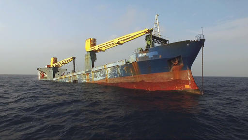 In this Jan. 20, 2017 photo provided by the Texas Parks and Wildlife Department, a former cargo vessel named Kraken sinks more than 60 miles off the coast of Galveston, Texas, to become an artificial reef. The ship is expected to become a home to fish, coral and other invertebrates plus being a destination for divers. (Texas Parks and Wildlife Department via AP)