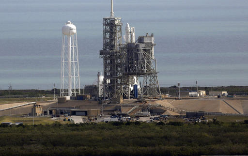 A Space X Falcon 9 rocket sits on the launch pad, Saturday, Feb. 18, 2017 at the Kennedy Space Center in Cape Canaveral, Fla Last-minute rocket trouble forced SpaceX on Saturday to delay its inaugural launch from NASA's historic moon pad. SpaceX halted the countdown with just 13 seconds remaining. The problem with the second-stage thrust control actually cropped up several minutes earlier. With just a single second to get the Falcon rocket airborne, flight controllers could not resolve the issue in time. (Red Huber/Orlando Sentinel via AP)