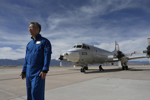 n this Feb. 17, 2017, photo, Ed Kim, a NASA researcher and lead scientist for a NASA-led experiment called SnowEx, stands near a Navy P-3 Orion aircraft used for SnowEx, at Peterson Air Force Base in Colorado Springs, Colo. Airplanes are scanning the Colorado high country with an array of sensors as scientists search for better ways to measure how much water is locked up in the world's mountain snows. (AP Photo/Brennan Linsley)