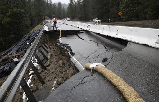 Heavy storms over the past two weeks caused parts of the shoulder and one lane of westbound Highway 50 give way, Tuesday, Feb. 21, 2017, near Pollock Pines, Calif. Crews have one lane open, of the four lane highway, as they work to repair the hole that is about 40 feet long and 17 feet wide on one of the main routes to Lake Tahoe. (AP Photo/Rich Pedroncelli)