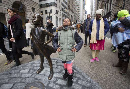 Shriya Gupta of Cherokee, N.C. strikes a pose with a statue titled