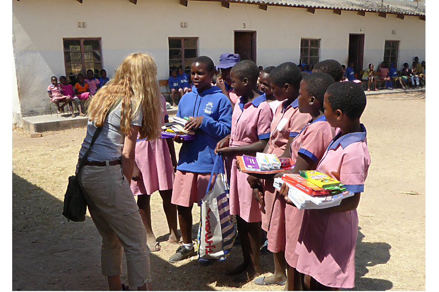 Julie Phippen, founder of Sewpportive Friends, visited rural village schools in Zimbabwe last summer to deliver kits that she and others had made. (Courtesy of Sewpportive Friends)