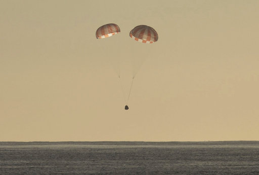 In this photo provided by SpaceX, the Dragon cargo ship parachutes into the Pacific off the Southern California coast on Sunday, March 19, 2017. Astronauts set it free from the International Space Station about 5½ hours earlier. (SpaceX via AP)