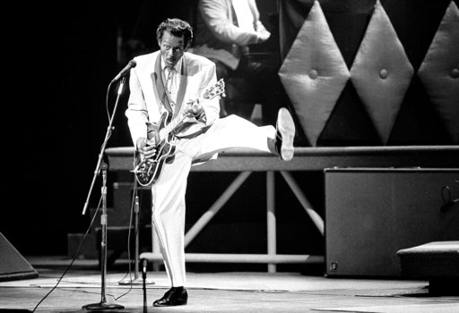 In this Oct. 17, 1986 file photo, Chuck Berry performs during a concert celebration for his 60th birthday at the Fox Theatre in St. Louis, Mo. On Saturday, March 18, 2017, police in Missouri said Berry has died at the age of 90. (AP Photo/James A. Finley)