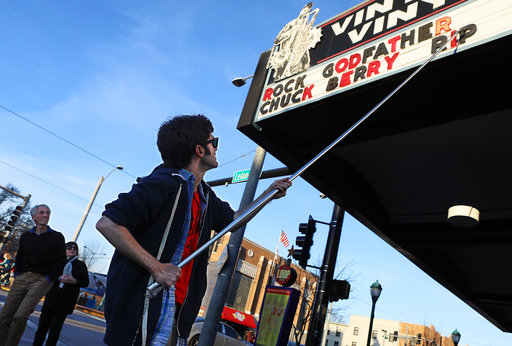 Teddy Kogos, of Vintage Vinyl, changes the marquee at the famed record store on the Delmar Loop in University City, Mo., to mark the death of music legend Chuck Berry on Saturday, March 18, 2017. Berry, rock 'n' roll's founding guitar hero and storyteller who defined the music's joy and rebellion in such classics as