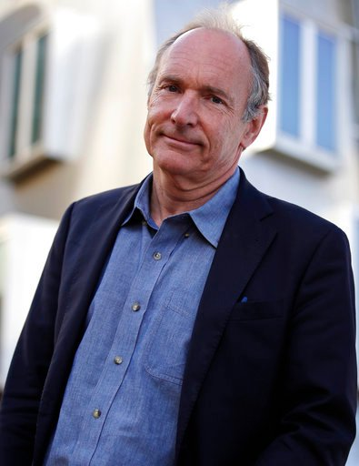 In this Monday, April 3, 2017, photo, Tim Berners-Lee poses outside his office at the Massachusetts Institute of Technology in Cambridge, Mass. Berners-Lee, best known as the inventor of the World Wide Web, is this year's recipient of the A.M. Turing Award, computing's version of the Nobel Prize. The honor comes with a $1 million prize funded by Google, one of many companies that made a fortune thanks to Berners-Lee's efforts to make the internet more accessible and useful. (AP Photo/Charles Krupa)