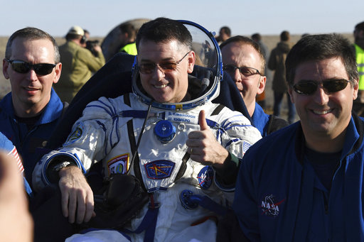 Ground personnel carry US astronaut Robert Shane Kimbrough shortly after landing near Dzhezkazgan, Kazakhstan Monday, April 10, 2017, on the treeless Central Asian steppes Russia's Soyuz MS-02 space capsule carrying the International Space Station (ISS) crew of Andrei Borisenko and Sergey Ryzhykov of Russia and NASA astronaut Robert Shane Kimbrough landed in a remote area in Kazakhstan. (Kirill Kudryavtsev/Pool photo via AP)