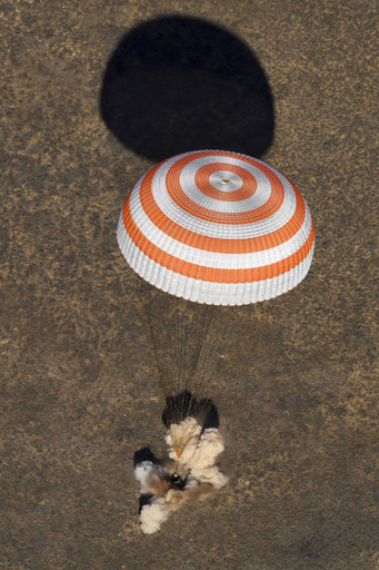 Russia's Soyuz MS-02 space capsule carrying the International Space Station (ISS) crew of Andrei Borisenko and Sergey Ryzhykov of Russia and NASA astronaut Robert Shane Kimbrough lands in a remote area in Kazakhstan, Monday, April 10, 2017. The landing took place near Dzhezkazgan on the treeless Central Asian steppes. (Kirill Kudryavtsev/Pool photo via AP)