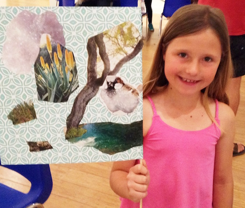 A young artist shows off her creation at the 2017 Imagination Celebration