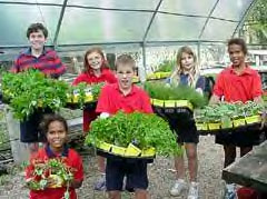 ACES students with their harvest