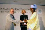 Fati Kirakoya receiving her Fellowship Certificate from Beatrice Dautresme, Executive VP of L'Oreal and Walter Erdelan, Assistant Director-General of UNESCO