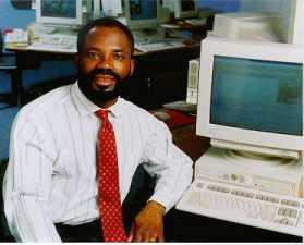 <a href=http://z.about.com/d/inventors/1/0/h/7/emeagwali_white_shirt_june_1996.jpg>Philip Emeagwali</a>