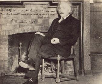 Albert Einstein sitting in a beautiful chair (Google )