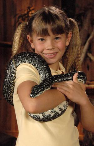 Bindi Irwin holding a snake