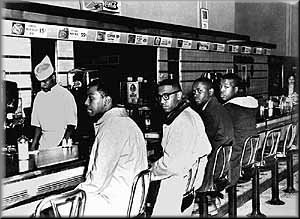 """Day 2 of Woolworth Sit-In: (L to R) Joseph McNeil, Franklin McCain, Billy Smith & Clarence Henderson, 02/02/60.<br>Photo by John """"Jack"""" Moebes as it appeared in the Greensboro <i>News and Record</i>"""