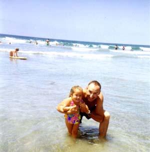 Stu and Caitlin in the ocean at Coronado Beach (Personal album)