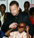 Bono with a child