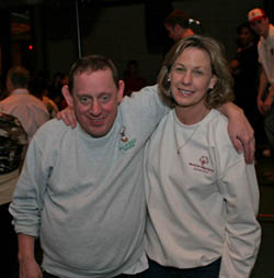 Lisa spends time with an athlete at a dance. (Special Olympics Connecticut)
