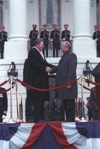 <p align=center>President Reagan and Soviet General Secretary Gorbachev shaking hands at the arrival ceremony on the White House south lawn  (Courtesy Ronald Reagan Library)</p>