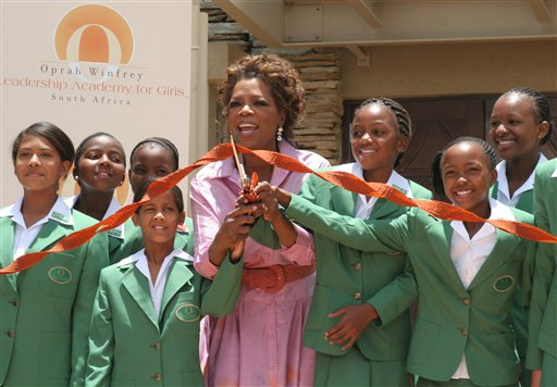 Oprah & students cut the ribbon at the school's opening ceremony. (AP Photo/Denis Farell)