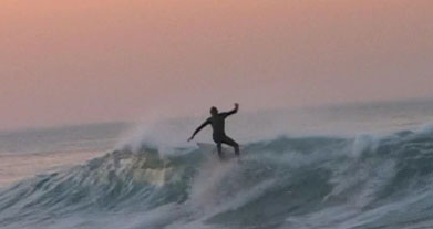 A Blue Water Task Force member enjoys the waves. (myhero.com)