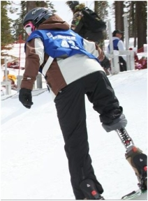 An adaptive athlete snowboarding (www.adaptiveactionsports.com)