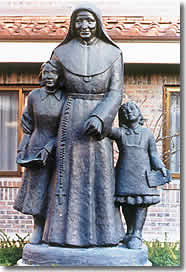 Statue of St. Julie Billiart with two children sh (http://www.snd1.org/Julie.html)