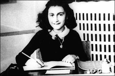 Anne Frank at her desk. (http://i.timeinc.net/time/time100/images)