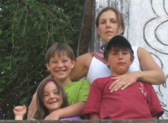 A picture of my mom, sister, brother and me<br>(Our personal collection)
