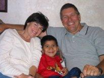 Melinda and Clark with an orphan (http://www.forhischildren-ecuador.org/fhcmain.php?pg=08)