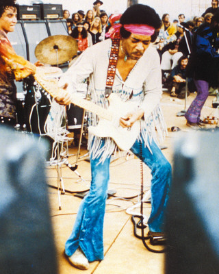 Jimi, playing at a concert. <br>(www.starpulse.com)