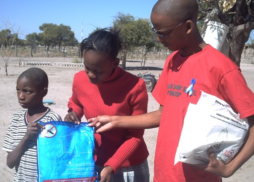 GSS Student Leader, Benson, assists village child (http://ads-gss.blogspot.com/)