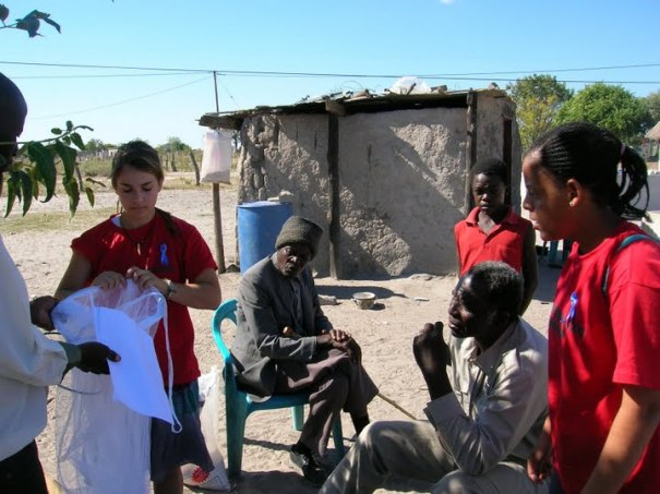 Student from ADS demonstrating bed nets to village citizen (http://ads-gss.blogspot.com/)