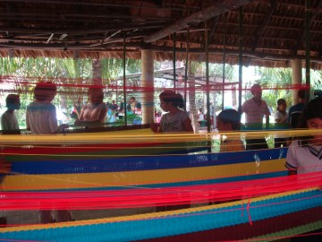 Students weaving hammocks. Weavers earn 25 dollars per hammock to support families.