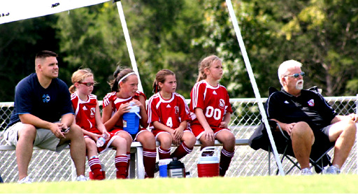 Jack Hitchens watches his U12 girls team play. (Hannah Leake)