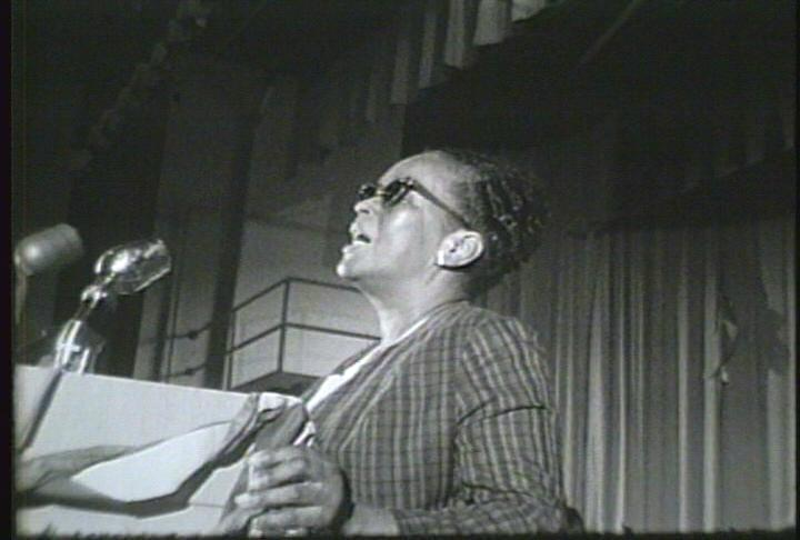 Ella Baker is giving a speech about rights for all people (<http://www.outreach.olemiss.edu/Freedom_Riders/screenshots/ )