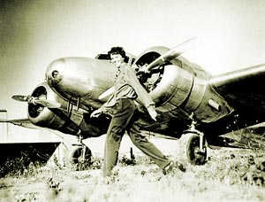 She is walking by her plane (http://www.ameliaearhart.com/about/historicalphotos.html)