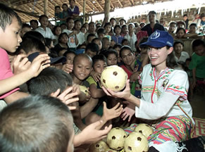 Jolie handing out toys in Cambodia. (http://www.solcomhouse.com/images/JolieField.jpg)